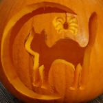 cat and moon carved into a pumpkin
